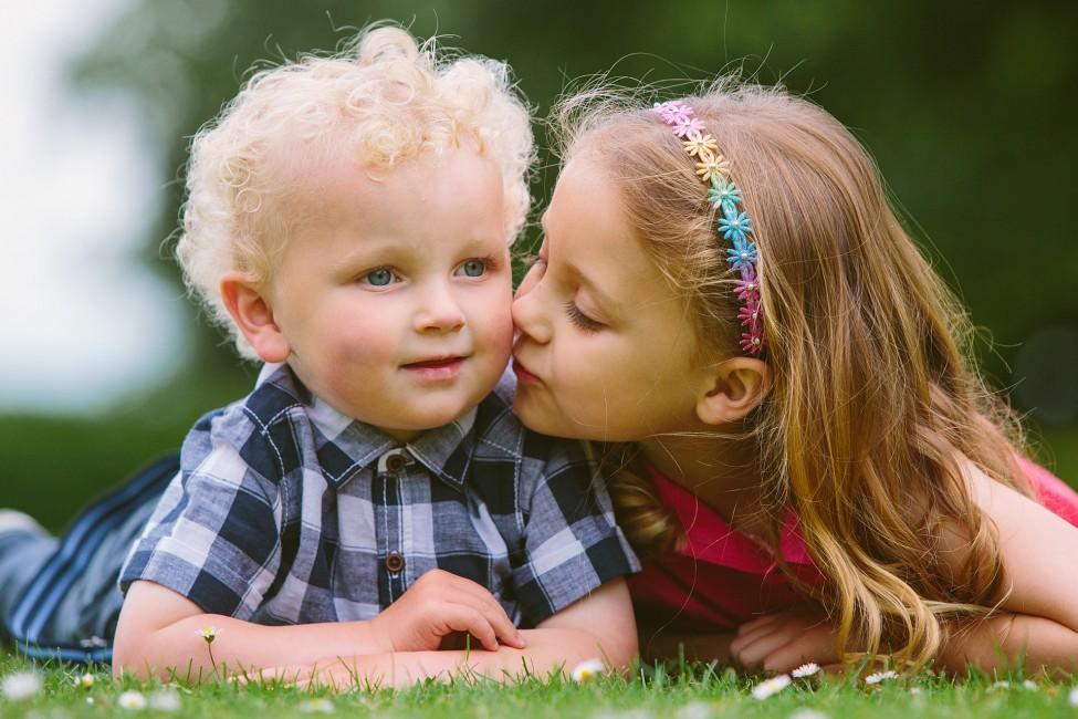 Location Portrait Shoot little girl kissing her little brother