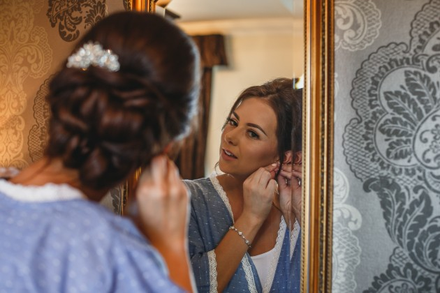 Stan-Seaton-photographyl-Bride-with-bride-Putting-in-earrings
