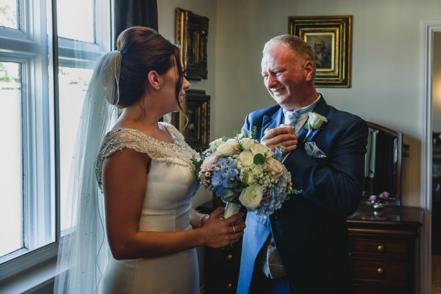 Stan-Seaton-photography-bride-getting-ready-greeting-father