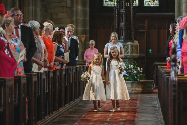 Stan-Seaton-Photography-bridesmaids-entering-the-church