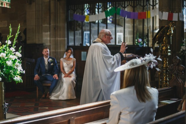 Stan-Seaton-Photography-bride-and-groom-listening-to-the-vicar