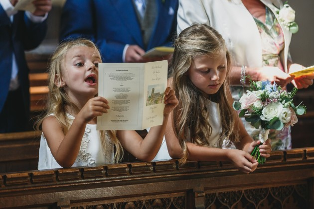 Stan-Seaton-Photography-young-bridesmaids-entering-the-church