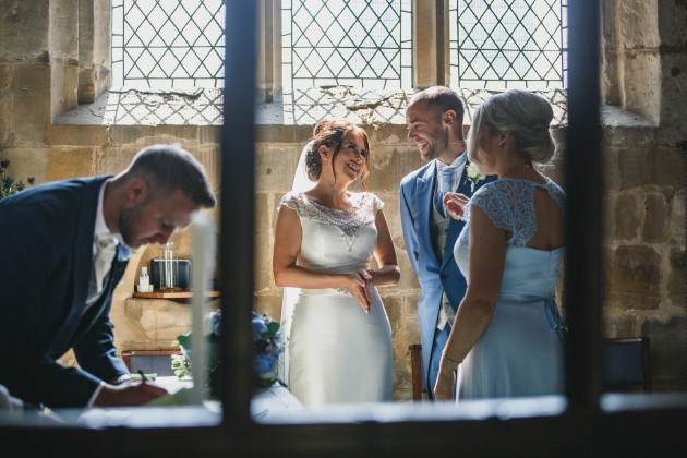 Stan-Seaton-Photography-groom-signing-the-register