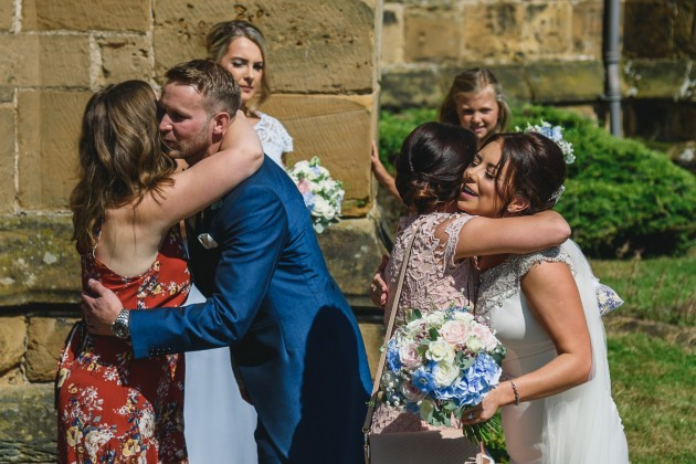 Stan-Seaton-Photography-bride-and-groom-greeting-guests