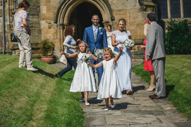 Stan-Seaton-Photography-bridesmaids-walking-out-of-the-church