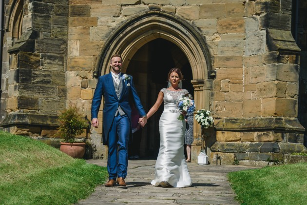 Stan-Seaton-Photography-bride-and-groom-walking-out-of-the-church