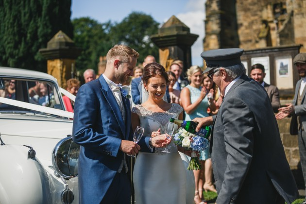 tan-Seaton-Photography-opening-champagne-at-church-gate