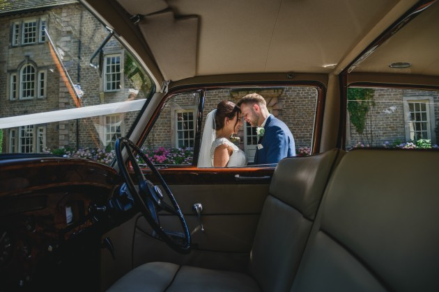tan-Seaton-Photography-Headlam-Hall-Bride-and-groom-with-the-wedding-car