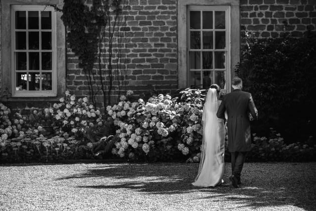 tan-Seaton-Photography-Headlam-Hall-Bride-and-groom-walking