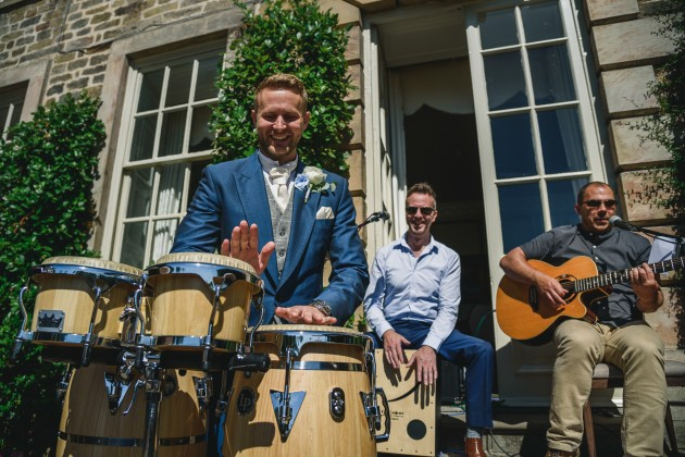 tan-Seaton-Photography-Headlam-Hall-groom-playing-the-drums