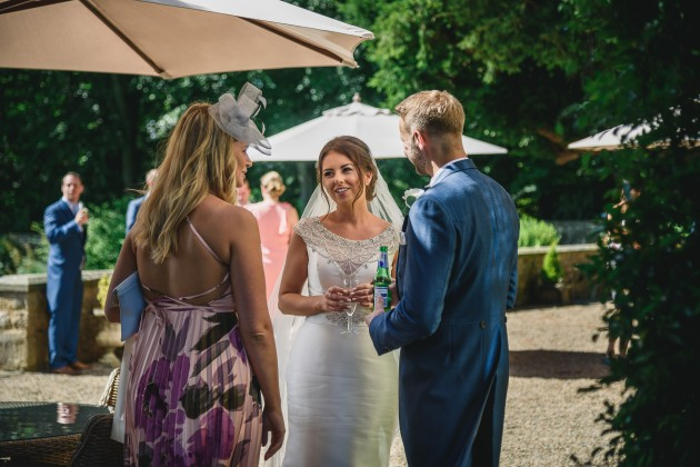 tan-Seaton-Photography-Headlam-Hall-bride-and-groom-talking-to-guests