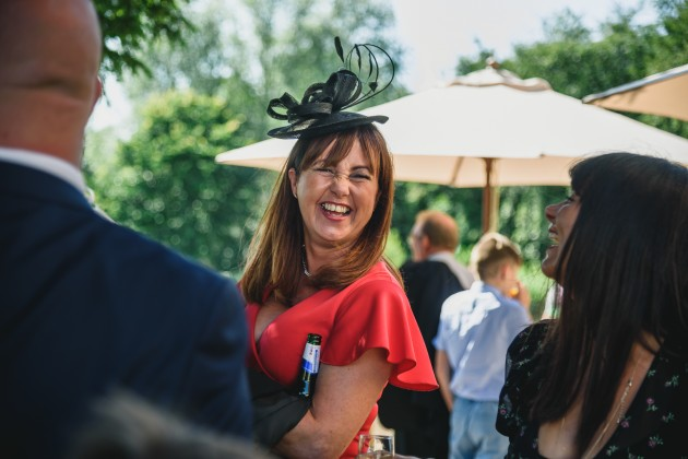 tan-Seaton-Photography-Headlam-Hall-wedding-guests-chatting