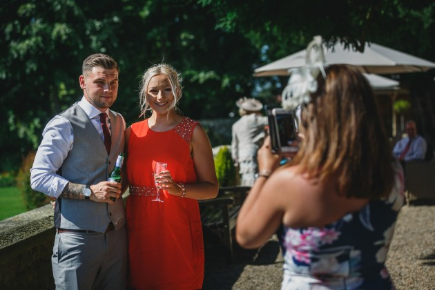 Stan-Seaton-Photography-Headlam-Hall-wedding-guests-chatting