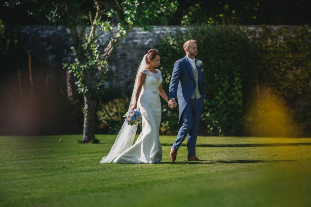 Stan-Seaton-Photography-Headlam-Hall-wedding-bride-and-groom-walking-on-the-lawn