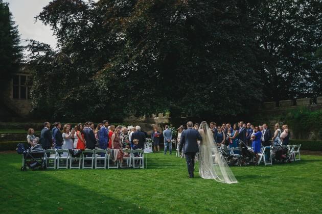 022 Durham-Wedding-Photographer-Stan-Seaton-Bride-Father-and-flower-girl-arriving.JPG