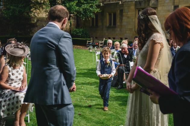 032 Durham-Castle-Wedding-Photographer-Stan-Seaton-ceremony-ring-bearer.JPG