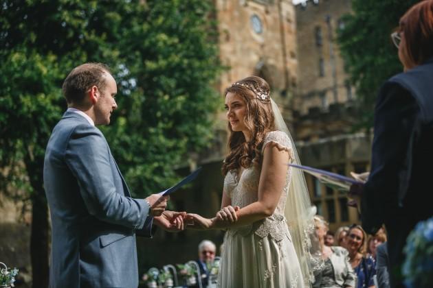 033 Durham-Castle-Wedding-Photographer-Stan-Seaton-bride-and-groom-exchanging views.JPG