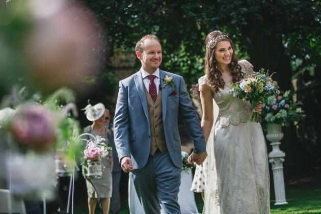 042 Durham-Castle-Wedding-Photographer-Stan-Seaton-bride-and-groom-walking-down-the-aisle.JPG