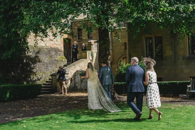 043 Durham-Castle-Wedding-Photographer-Stan-Seaton-bride-and-groom-walking-down-the-aisle.JPG