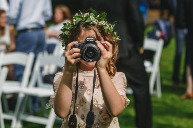 045 Durham-Castle-Wedding-Photographer-Stan-Seaton-flower-girl-taking-a-photograph.JPG