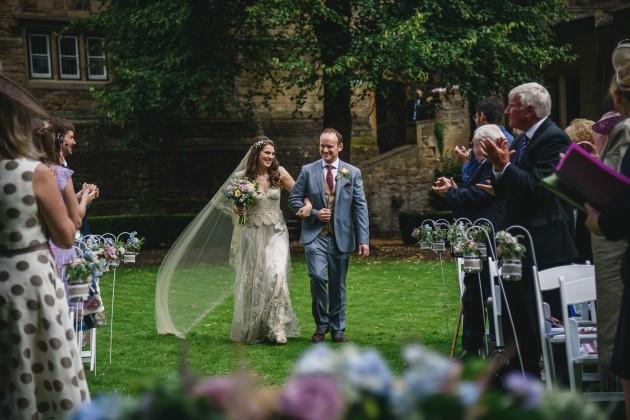 047 Durham-Castle-Wedding-Photographer-Stan-Seaton-bride-and-groom-walking-down-the-aisle.JPG