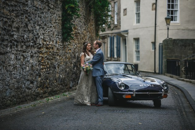 067 Durham-Castle-Wedding-Photographer-Stan-Seaton-bride-and-groom-in-the-cobbled-streets.JPG