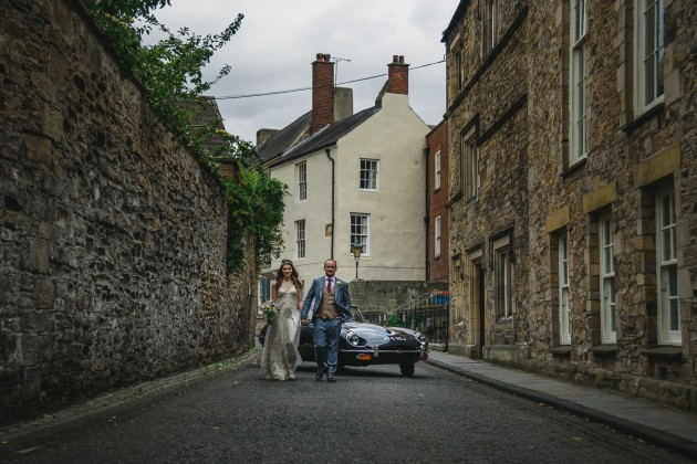 068 Durham-Castle-Wedding-Photographer-Stan-Seaton-bride-and-groom-walking-through-the-cobbled-streets.JPG