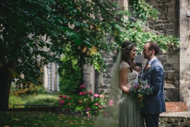 071 Durham-Castle-Wedding-Photographer-Stan-Seaton-bride-and-groom-in-hatfield-college-garden.JPG
