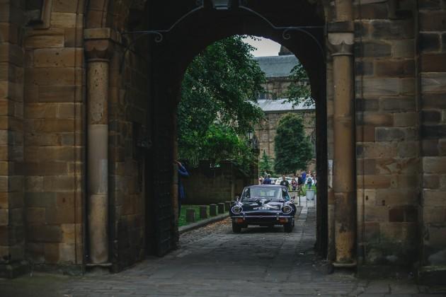076 Durham-Castle-Wedding-Photographer-Stan-Seaton-Bride-and-groom-returning-tothe-castle.JPG