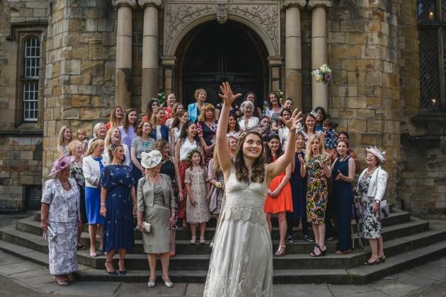 078Wedding-Photography-Durham-Castle-Stan-Seaton-Bride-throwing-Bouquet.JPG