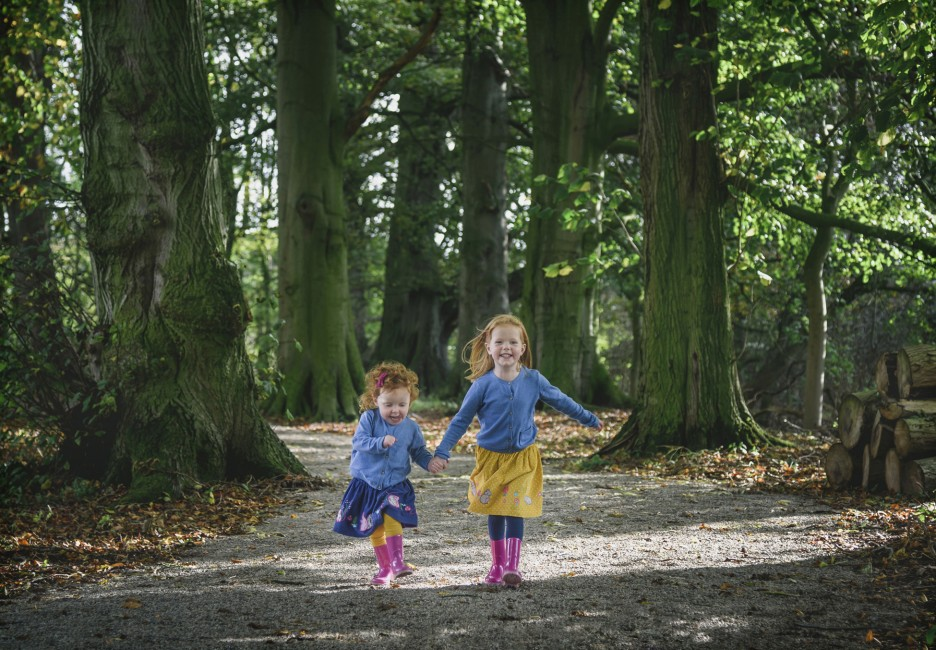 Stan-Seaton-Portrait-Photography-Sisters holding-hands-and-running.jpg